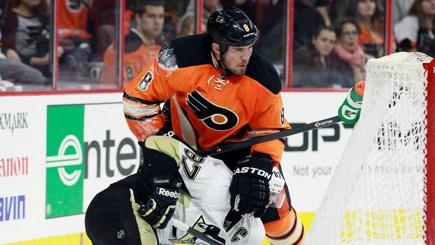 Philadelphia Flyers defenseman Nicklas Grossmann holds Pittsburgh Penguins' Sidney Crosby down on the ice behind the net in the third period of an NHL hockey game, Sunday, April 5, 2015, in Philadelphia. The Flyers won 4-1. (AP Photo/Tom Mihalek)