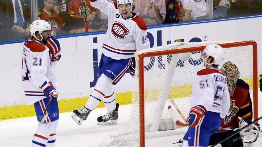 Montreal Canadiens right wing P.A. Parenteau (15) and center David Desharnais (51) celebrate after right wing Devante Smith-Pelly (21) scored a goal during the second period of an NHL hockey game against the Florida Panthers, Sunday, April 5, 2015 in Sunrise, Fla. (AP Photo/Wilfredo Lee)