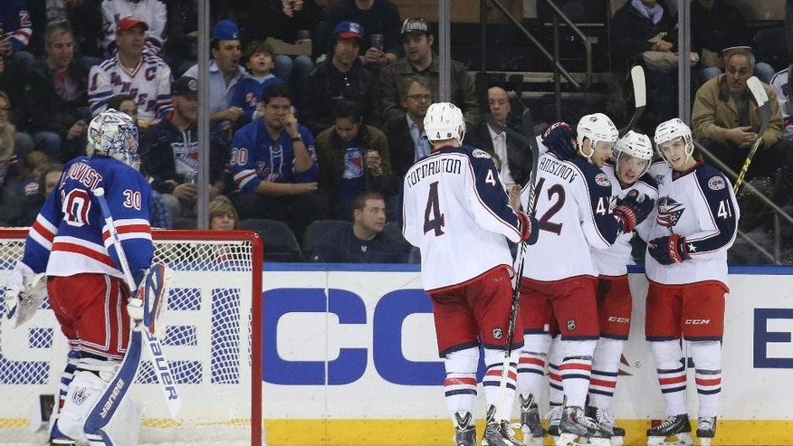 Columbus Blue Jackets center Marko Dano, second from right, celebrates his goal on New York Rangers goalie Henrik Lundqvist, left, during the second period of an NHL hockey game, Monday, April 6, 2015, in New York. (AP Photo/John Minchillo)