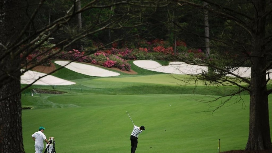 Rory McIlroy, of Northern Ireland, hits to the 13th green during a practice round for the Masters golf tournament Monday, April 6, 2015, in Augusta, Ga. (AP Photo/Matt Slocum)