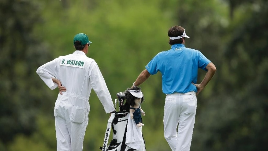 Bubba Watson leans on his golf back with hs caddie on the fifth hole during a practice round for the Masters golf tournament Monday, April 6, 2015, in Augusta, Ga. (AP Photo/Matt Slocum)