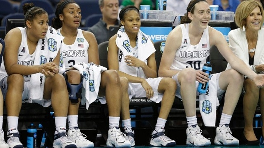 April 5, 2015: The Connecticut bench watches play against Maryland during the second half of the NCAA Women's Final Four tournament college basketball semifinal game in Tampa, Fla. Connecticut won 81-58. (AP Photo/John Raoux)