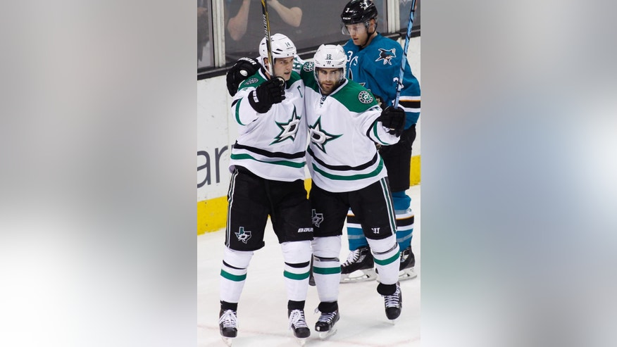 Dallas Stars' Patrick Eaves, right, celebrates with teammate Jamie Benn after scoring a goal against the San Jose Sharks during the first period of an NHL hockey game, Monday, April 6, 2015, in San Jose, Calif.  San Jose Sharks, Karl Stollery is behind. (AP Photo/George Nikitin)