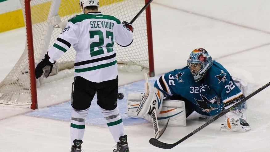 Dallas Stars' Colton Sceviour (22) scores a goal past San Jose Sharks goalie Alex Stalock during the first period of an NHL hockey game, Monday, April 6, 2015, in San Jose, Calif. (AP Photo/George Nikitin)