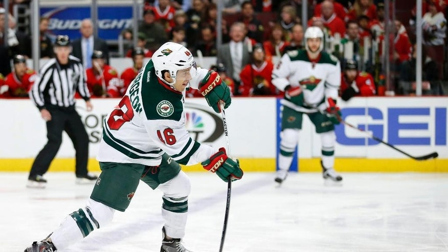 Minnesota Wild defenseman Jared Spurgeon (46) tries to score against the Chicago Blackhawks during the first period of an NHL hockey game Tuesday, April 7, 2015, in Chicago. (AP Photo/Kamil Krzaczynski)