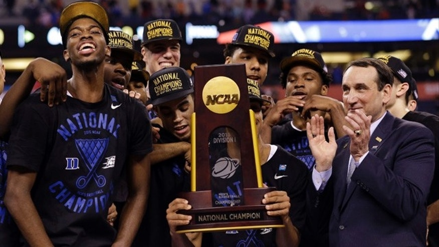 April 6, 2015: Duke players celebrate with the trophy after their 68-63 victory over Wisconsin in the NCAA Final Four college basketball tournament championship game in Indianapolis. (AP Photo/David J. Phillip)