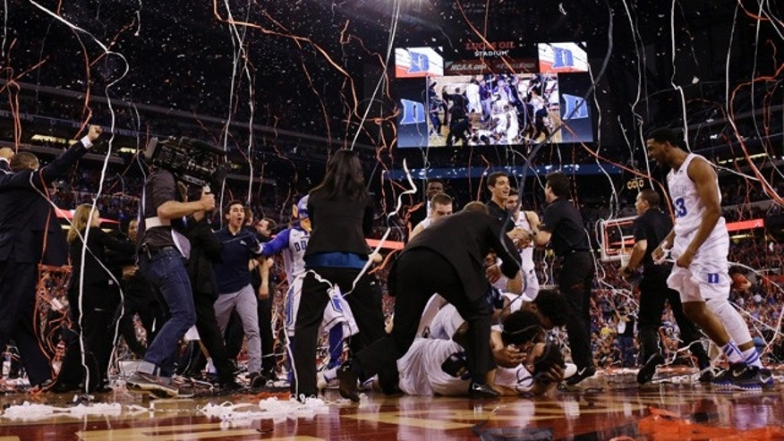 April 6, 2015: Duke players celebrate their 68-63 victory over Wisconsin in the NCAA Final Four college basketball tournament championship game in Indianapolis. (AP Photo/David J. Phillip)