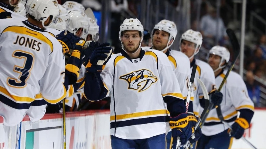 Nashville Predators center Calle Jarnkrok (19), of Sweden, is congratulated after scoring a goal against the Colorado Avalanche during the first period of an NHL hockey game Tuesday, April 7, 2015, in Denver. (AP Photo/David Zalubowski)
