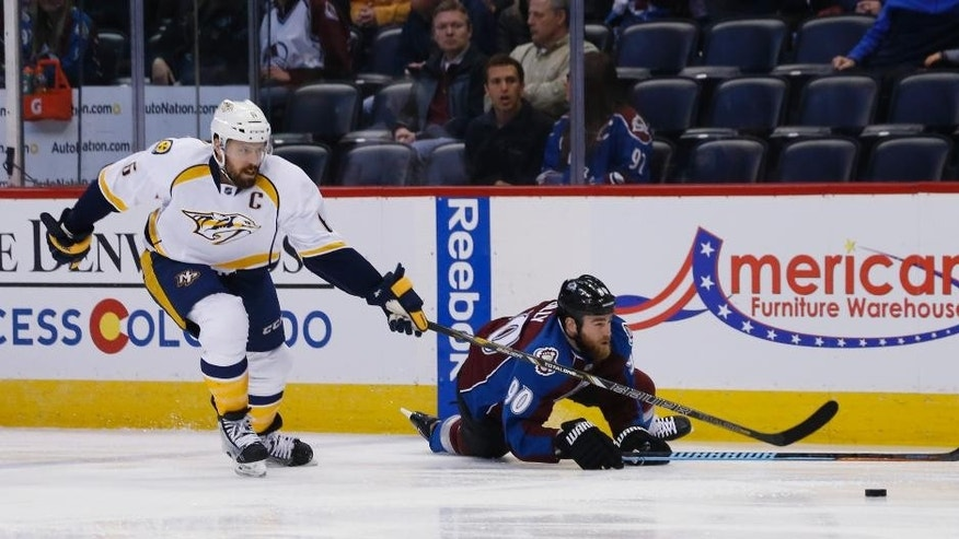 Nashville Predators defenseman Shea Weber, left, knocks over Colorado Avalanche center Ryan O'Reilly during the first period of an NHL hockey game Tuesday, April 7, 2015, in Denver. (AP Photo/David Zalubowski)
