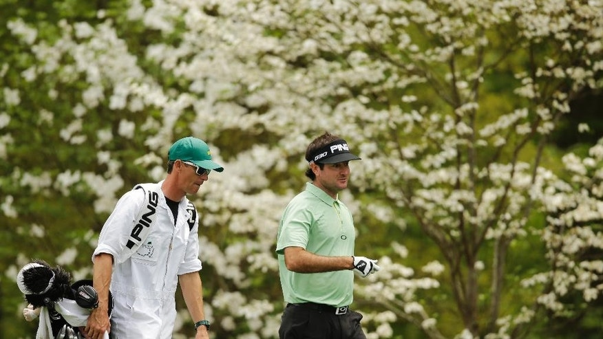 Bubba Watson walks with his caddie on the 11th hole during a practice round for the Masters golf tournament Tuesday, April 7, 2015, in Augusta, Ga. (AP Photo/Matt Slocum)