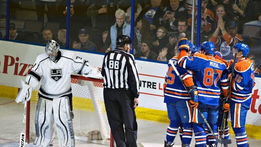 Los Angeles Kings goalie Martin Jones (31) clears the crease as the Edmonton Oilers celebrate a goal during the second period of an NHL hockey game Tuesday, April 7, 2015, in Edmonton, Alberta. (AP Photo/The Canadian Press, Jason Franson)