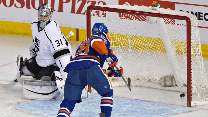Los Angeles Kings goalie Martin Jones (31) is scored on by Edmonton Oilers' Matt Fraser (28) during the second period of an NHL hockey game Tuesday, April 7, 2015, in Edmonton, Alberta. (AP Photo/The Canadian Press, Jason Franson)