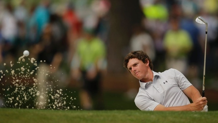 Amateur Matias Dominguez, of Chile, hits to the seventh green during a practice round for the Masters golf tournament Tuesday, April 7, 2015, in Augusta, Ga. (AP Photo/Matt Slocum)