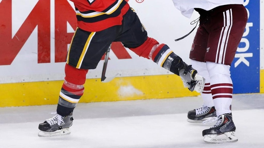 Arizona Coyotes' B.J. Crombeen, right, hits Calgary Flames' TJ Brodie during the second period of an NHL hockey game, Tuesday, April 7, 2015 in Calgary, Alberta.  (AP Photo/The Canadian Press, Larry MacDougal)