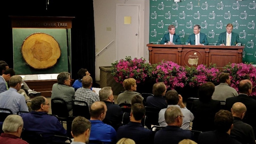 Flanked by Fred Ridley, left and Craig Heathley, Billy Payne, Chairman of the Augusta National Golf Club speaks to reporters during a practice round for the Masters golf tournament Wednesday, April 8, 2015, in Augusta, Ga. (AP Photo/Chris Carlson)