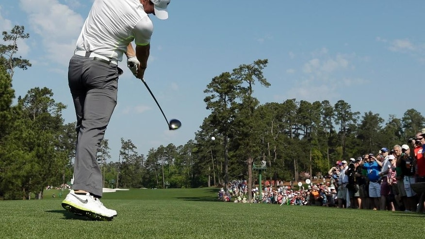 Rory McIlroy, of Northern Ireland, tees off on the third hole during a practice round for the Masters golf tournament Wednesday, April 8, 2015, in Augusta, Ga. (AP Photo/Charlie Riedel)
