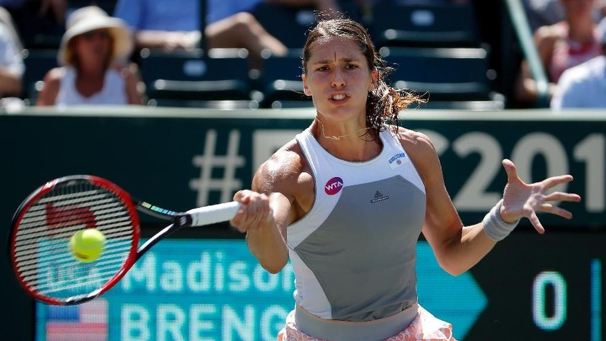 Andrea Petkovic of Germany, hits against Madison Brengle during the third round of the Family Circle Cup tennis tournament in Charleston, S.C., Thursday, April 9, 2015. Petkovic beat Brengle 6-4 6-4. (AP Photo/Stephen B. Morton)