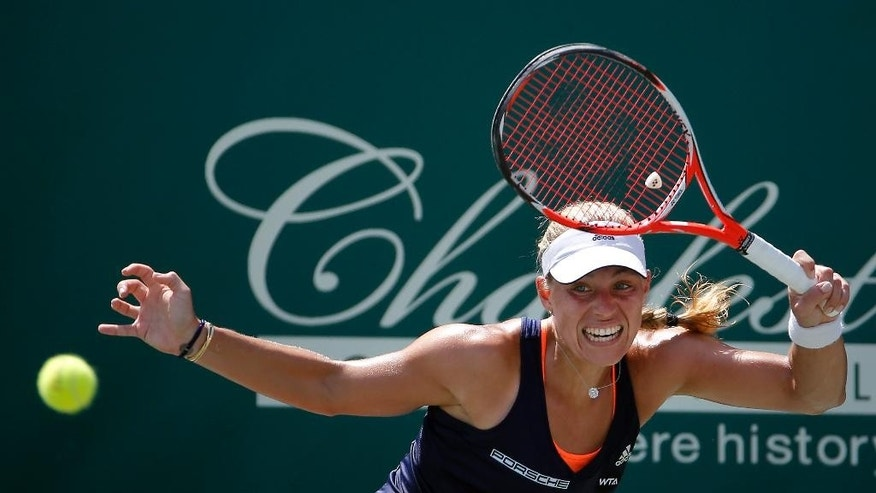 Angelique Kerber of Germany, hits a forehand against Lara Arruabarrena of Spain, in the third round of the Family Circle Cup tennis tournament in Charleston, S.C., Thursday, April 9, 2015. (AP Photo/Stephen B. Morton)