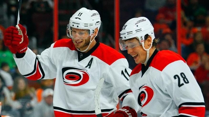 Carolina Hurricanes' Jordan Staal, left, and Alexander Semin celebrate the goal by Brett Bellemore, not pictured, in the first period of an NHL hockey game against the Philadelphia Flyers, Thursday, April 9, 2015, in Philadelphia.(AP Photo/Tom Mihalek)