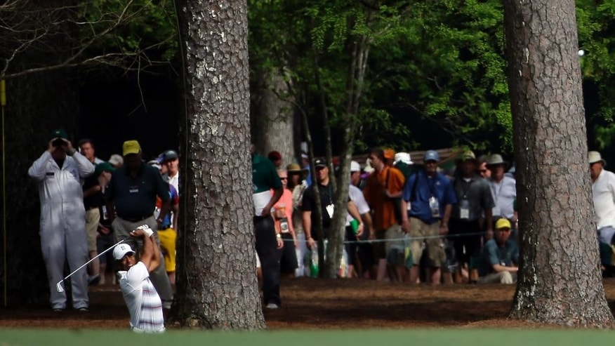 Tiger Woods hits on the 13th fairway during the first round of the Masters golf tournament Thursday, April 9, 2015, in Augusta, Ga. (AP Photo/David J. Phillip)