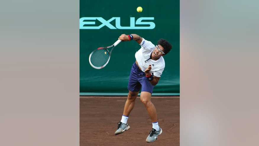 Hyeon Chung from South Korea returns a shot to Fernando Verdasco of Spain in a match at the U.S. Men's Clay Court Championship Thursday, April 9, 2015, in Houston. (AP Photo/Pat Sullivan)