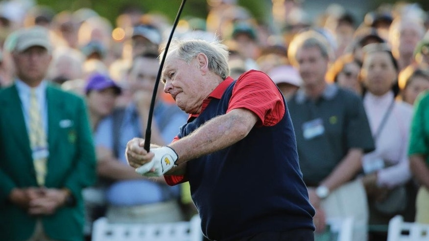 Jack Nicklaus hits on the first tee for the honorary tee off before the first round of the Masters golf tournament Thursday, April 9, 2015, in Augusta, Ga. (AP Photo/David J. Phillip)