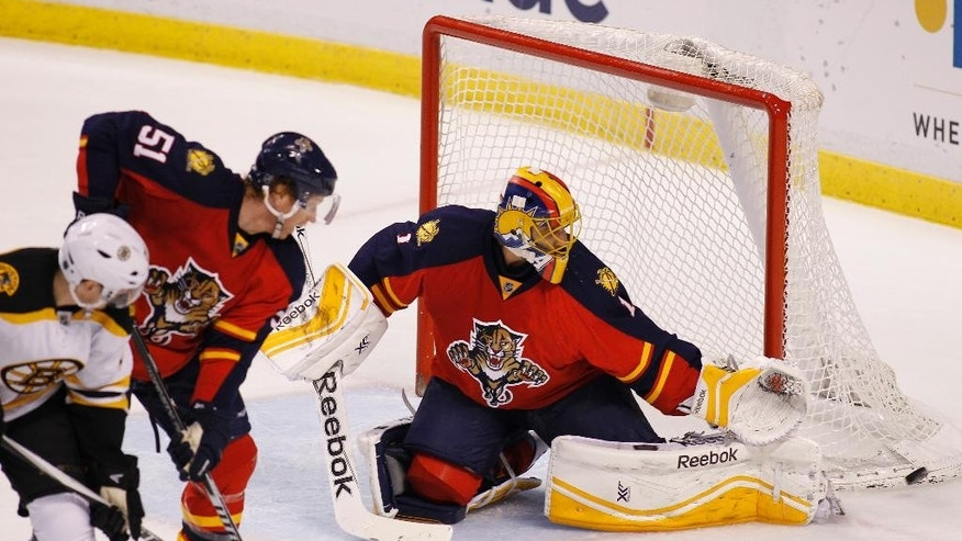 Florida Panthers goalie Roberto Luongo (1) and Brian Campbell (51) defend against Boston Bruins left wing Loui Eriksson (21) during the first period of an NHL hockey game Thursday, April 9, 2015, in Sunrise, Fla. (AP Photo/Terry Renna)