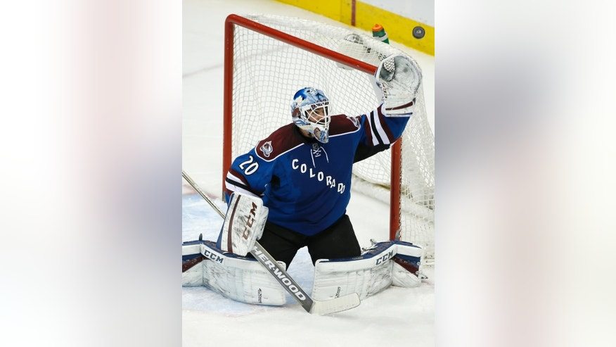 Colorado Avalanche goalie Reto Berra makes a save against the Winnipeg Jets during the first period of an NHL hockey game, Thursday, April 9, 2015, in Denver. (AP Photo/Jack Dempsey)
