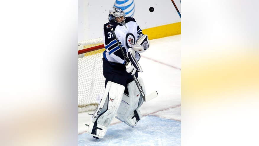 Winnipeg Jets goalie Ondrej Pavelec (31) blocks a shot agains the Colorado Avalanche during the first period of an NHL hockey game, Thursday, April 9, 2015, in Denver. (AP Photo/Jack Dempsey)