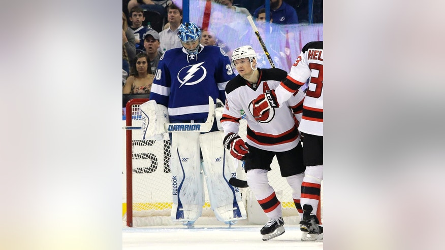 New Jersey Devils left wing Patrik Elias (26), of the Czech Republic, celebrates after scoring past Tampa Bay Lightning goalie Ben Bishop (30) during the second period of an NHL hockey game Thursday, April 9, 2015, in Tampa, Fla. (AP Photo/Chris O'Meara)