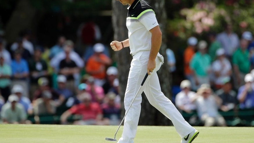 Rory McIlroy, of Northern Ireland, pumps his fist after a birdie on the 15th hole during the first round of the Masters golf tournament Thursday, April 9, 2015, in Augusta, Ga. (AP Photo/Matt Slocum)