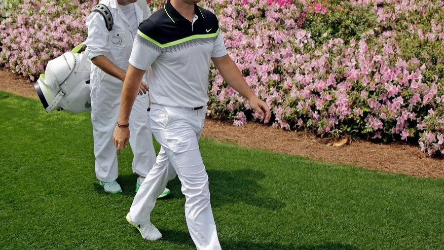 Rory McIlroy, of Northern Ireland, walks along the sixth fairway during the first round of the Masters golf tournament Thursday, April 9, 2015, in Augusta, Ga. (AP Photo/Matt Slocum)
