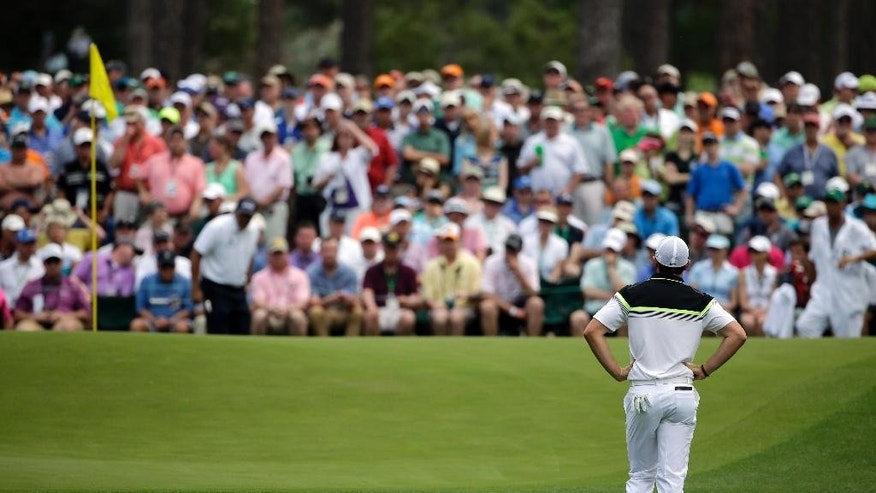 Rory McIlroy, of Northern Ireland, waits to putt on the sixth green during the first round of the Masters golf tournament Thursday, April 9, 2015, in Augusta, Ga. (AP Photo/Matt Slocum)