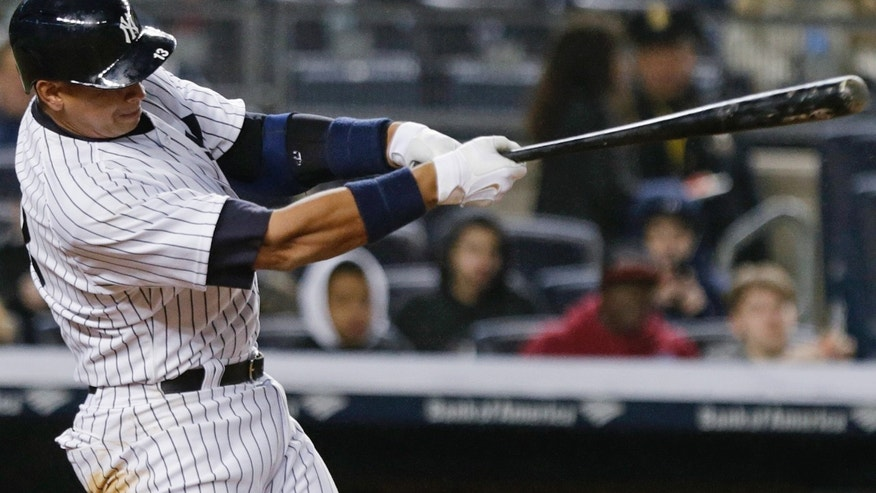 New York Yankees' Alex Rodriguez follows through on a home run during the sixth inning of a baseball game against the Toronto Blue Jays on Thursday, April 9, 2015, in New York. (AP Photo/Frank Franklin II)