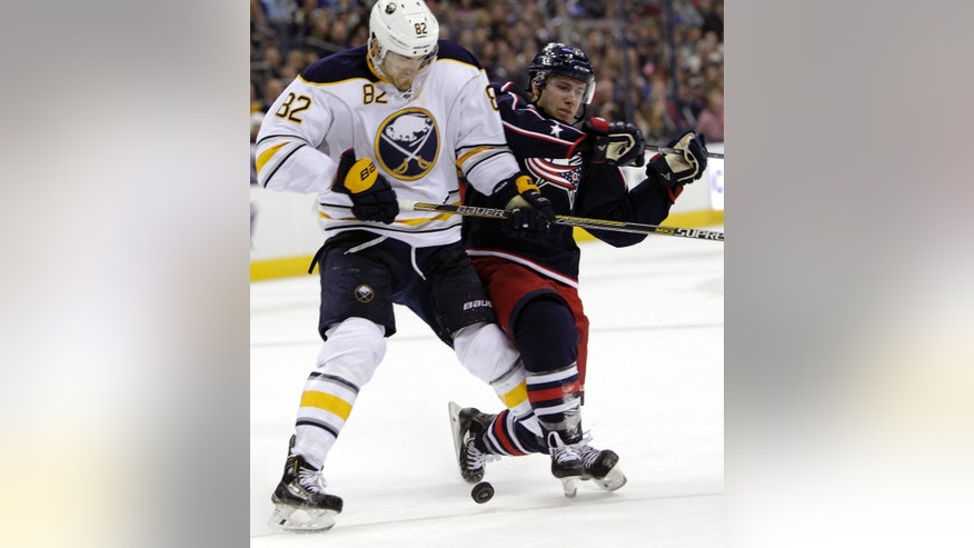 Buffalo Sabres' Marcus Foligno, left, and Columbus Blue Jackets' Ryan Murray fight for the puck during the second period of an NHL hockey game Friday, April 10, 2015, in Columbus, Ohio. (AP Photo/Jay LaPrete)
