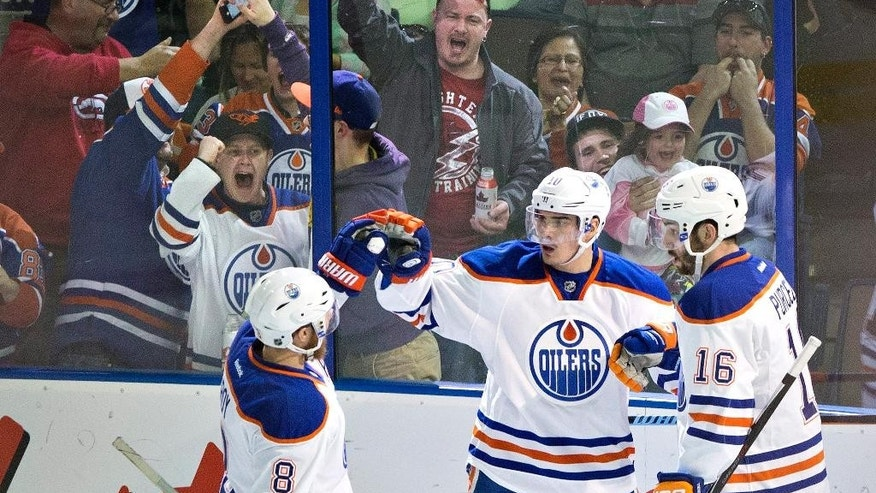 Edmonton Oilers Derek Roy (8), Nail Yakupov (10) and Teddy Purcell (16) celebrate a goal against San Jose Sharks during the second period of an NHL hockey game, Thursday, April 9, 2015 in Edmonton, Alberta.  (AP Photo/The Canadian Press, Jason Franson)