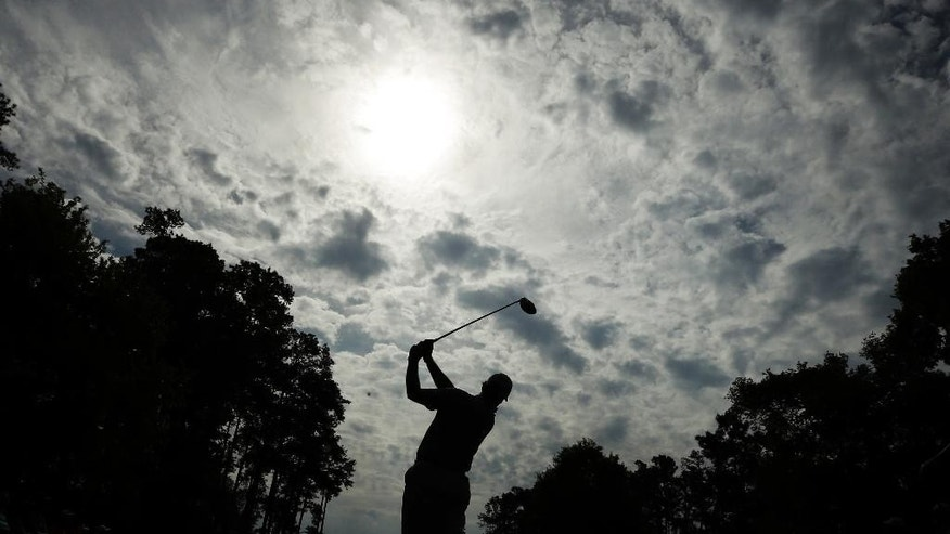 Ernie Els, of South Africa, tees off on the seventh hole during the second round of the Masters golf tournament Friday, April 10, 2015, in Augusta, Ga. (AP Photo/Charlie Riedel)