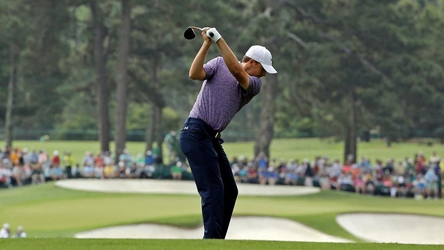 Jordan Spieth hits on the second fairway during the second round of the Masters golf tournament Friday, April 10, 2015, in Augusta, Ga. (AP Photo/David J. Phillip)