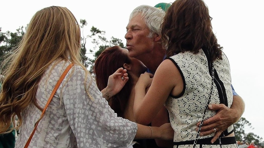 Ben Crenshaw is greeted by his family after his final round of the Masters golf tournament Friday, April 10, 2015, in Augusta, Ga.  (AP Photo/Matt Slocum)