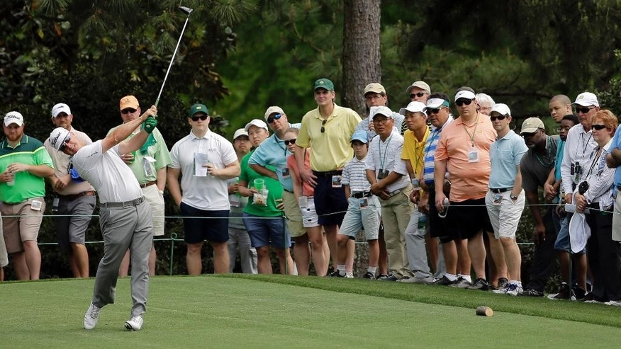 Charley Hoffman tees off on the 15th hole during the second round of the Masters golf tournament Friday, April 10, 2015, in Augusta, Ga. (AP Photo/David J. Phillip)