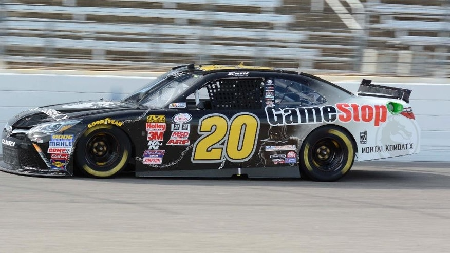NASCAR XFinity Series driver Erik Jones (20) drives during qualifying for the O'Reilly Auto Parts 500 auto race at Texas Motor Speedway in Fort Worth, Texas, Friday, April 10, 2015. Jones will start in the pole position. (AP Photo/Larry Papke)