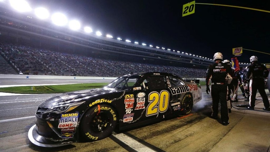 Erik Jones pulls away after a pit stop during the NASCAR Xfinity series auto race at Texas Motor Speedway in Fort Worth, Texas, Friday, April 10, 2015. (AP Photo/Tim Sharp)