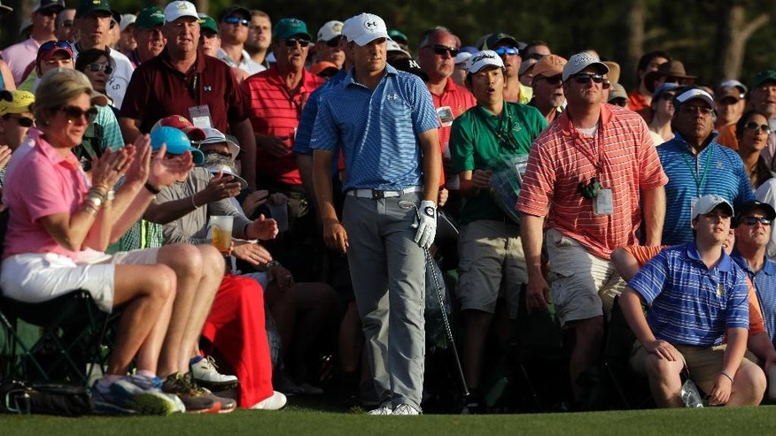 Jordan Spieth watches his hit out of the gallery on the 18th hole during the third round of the Masters golf tournament Saturday, April 11, 2015, in Augusta, Ga. (AP Photo/Chris Carlson)