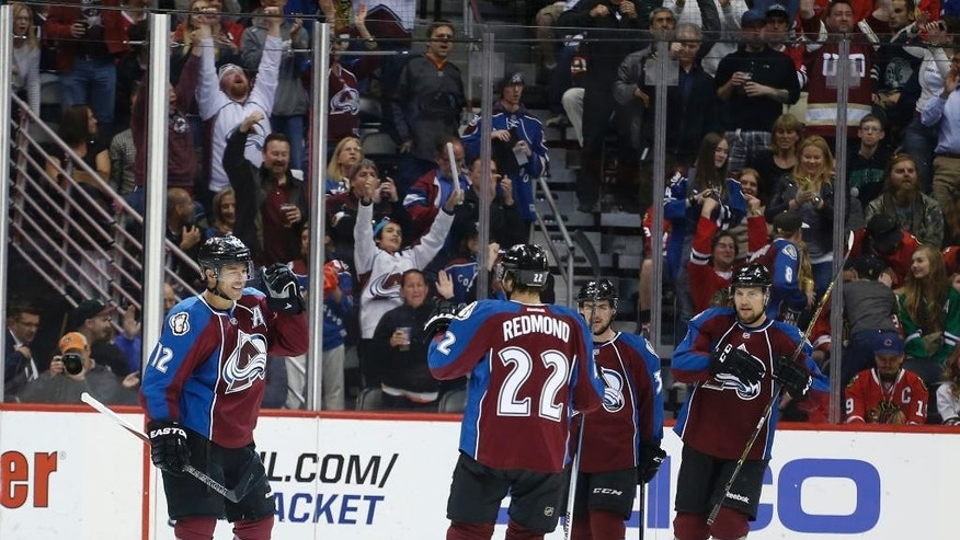 Colorado Avalanche right wing Jarome Iginla (12) celebrates his goal against the Chicago Blackhawks with teammates, including Zach Redmond (22), during the second period of an NHL hockey game Saturday, April 11, 2015, in Denver. (AP Photo/Jack Dempsey)