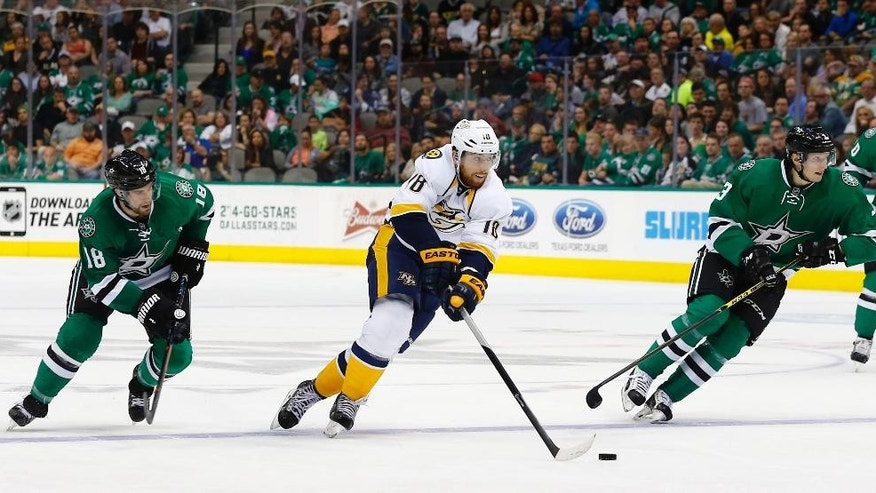 Nashville Predators' James Neal (18) skates the puck between Dallas Stars' Patrick Eaves (18) and John Klingberg (3) during the second period of an NHL hockey game, Saturday, April, 11, 2015, in Dallas. (AP Photo/Mike Stone)