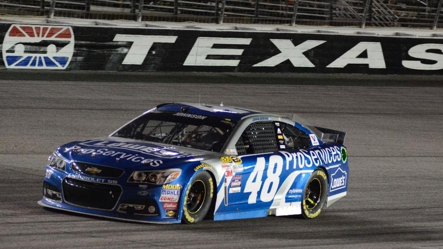 Jimmie Johnson (48) heads to the pits during the NASCAR Sprint Cup auto race at Texas Motor Speedway in Fort Worth, Texas, Saturday, April 11, 2015. (AP Photo/Larry Papke)