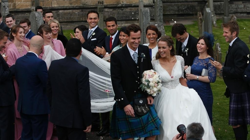 Britain's Andy Murray and Kim Sears leave Dunblane Cathedral in Scotland after their wedding, Saturday April 11, 2015. (AP Photo/PA, Andrew Milligan) UNITED KINGDOM OUT  NO SALES  NO ARCHIVE