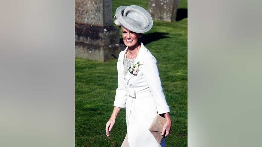 Judy Murray arrives for the wedding of her son British tennis number one Andy Murray to his long-term girlfriend, Kim Sears, at Dunblane Cathedral, Scotland, in his home town Saturday, April 11, 2015. (AP Photo/PA, Danny Lawson)  UNITED KINGDOM OUT  NO SALES  NO ARCHIVE
