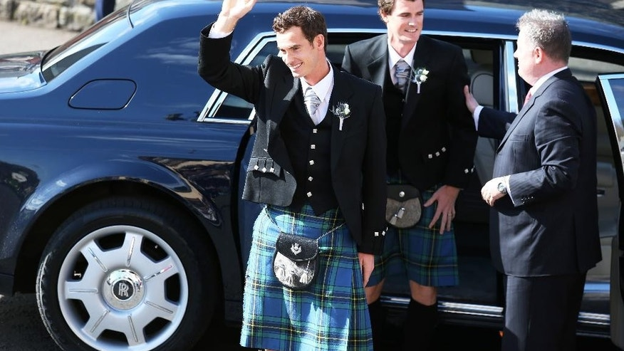 Britain's Andy Murray arrives for his wedding to Kim Sears, with his brother Jamie, center, at Dunblane Cathedral in Scotland, Saturday April 11, 2015. (AP Photo/PA, Andrew Milligan) UNITED KINGDOM OUT  NO SALES  NO ARCHIVE