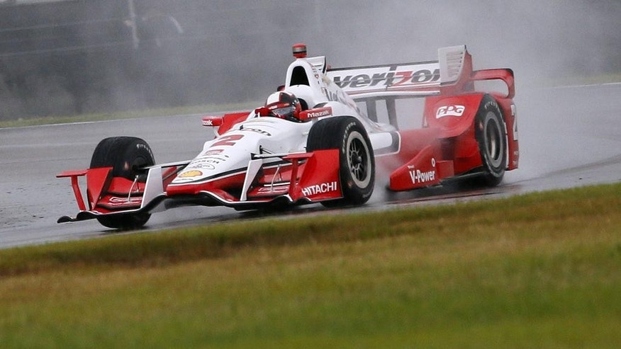 Juan Pablo Montoya, of Colombia, drives during qualifying for the IndyCar Grand Prix of Louisiana auto race, Saturday, April 11, 2015, in Avondale, La. Qualifications were canceled due to rain. (AP Photo/Jonathan Bachman)